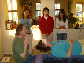 david says Reiki prayer before teaching positions with orb present in shot